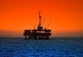 sunset on oil rig platform